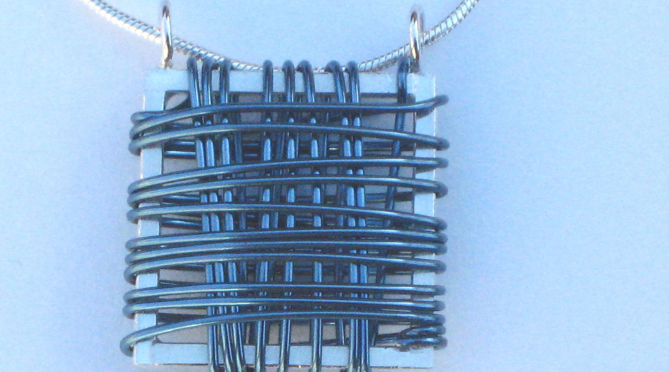 Silver & Niobium Basket Pendant on 18'' silver snake chain. Blue. £40