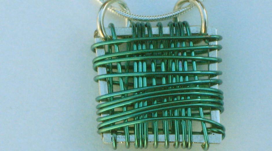 Silver & Niobium Basket Pendant on 18'' silver snake chain. Green. £40